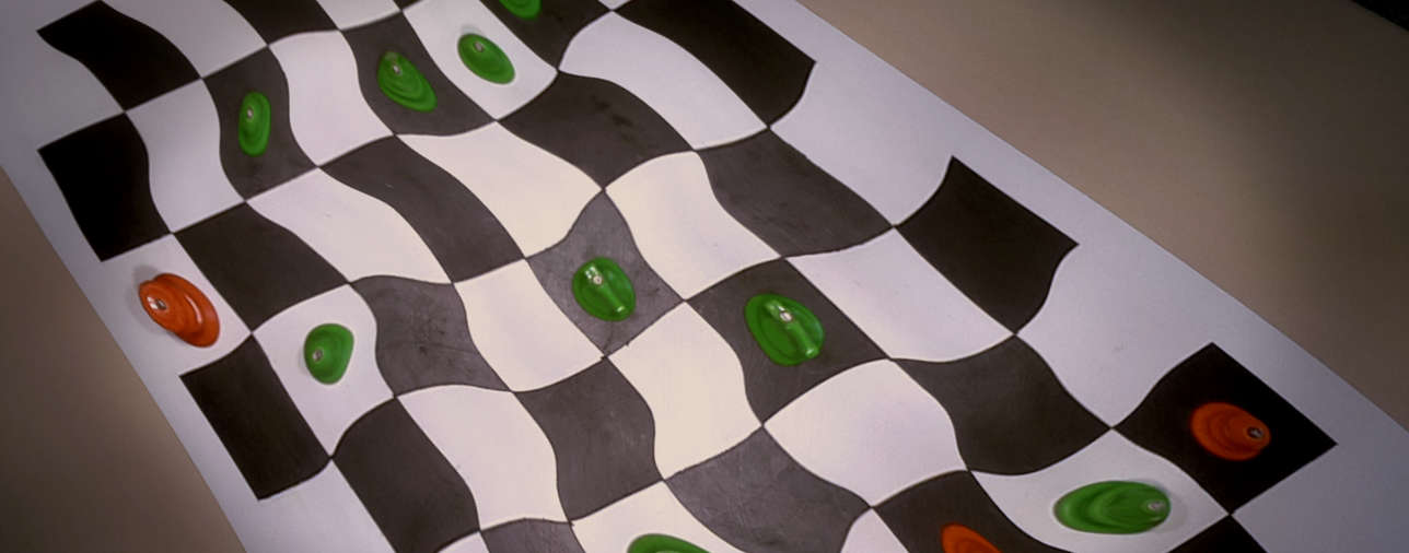 Abstract image of distorted chessboard.