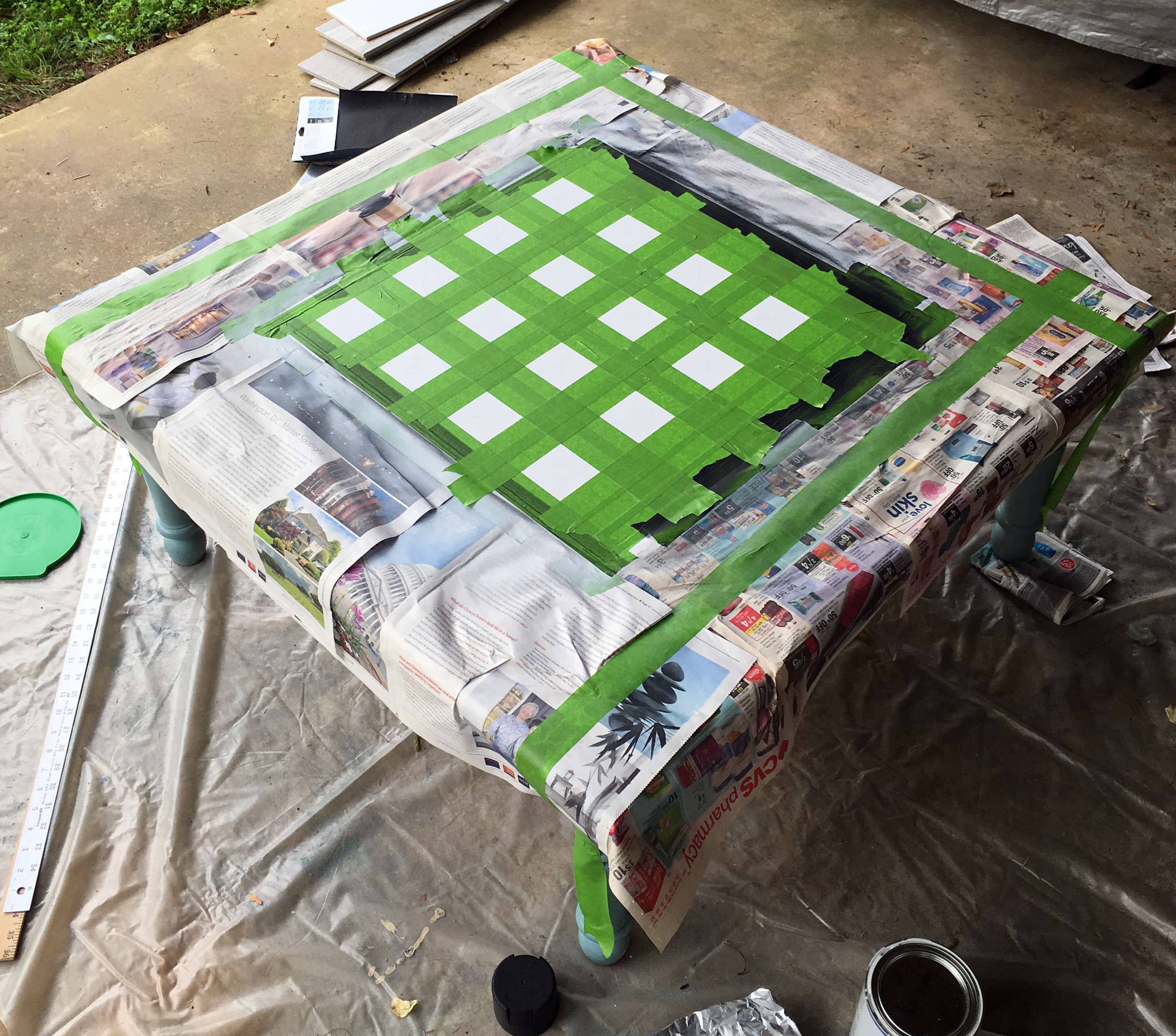 Painting the table with FrogTape and matte spray paint.