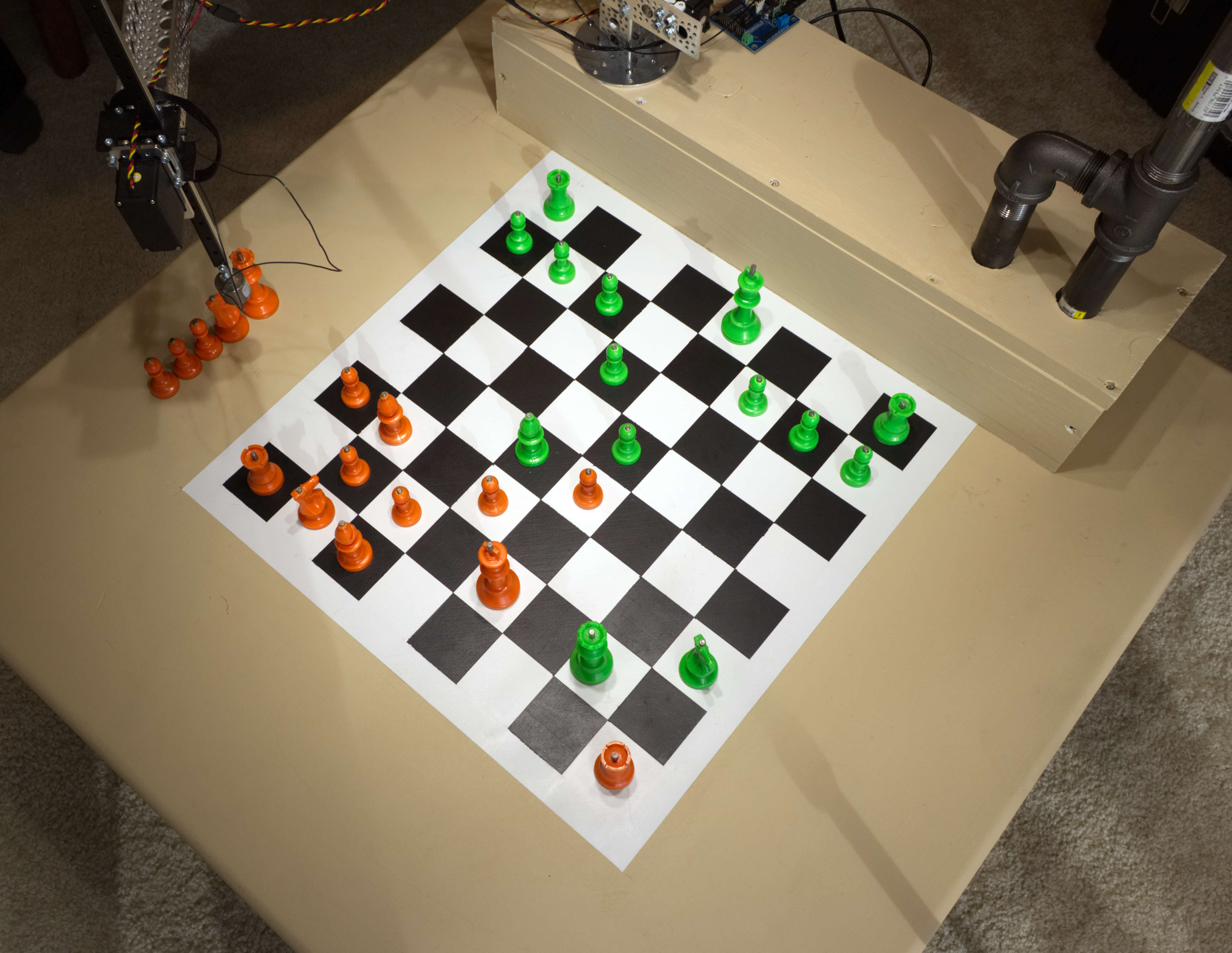 The chessboard on the table.